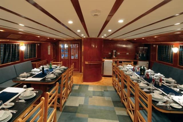 mv blue melody dining area liveaboard review