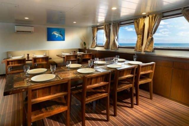mv blue manta indoor dining liveaboard review